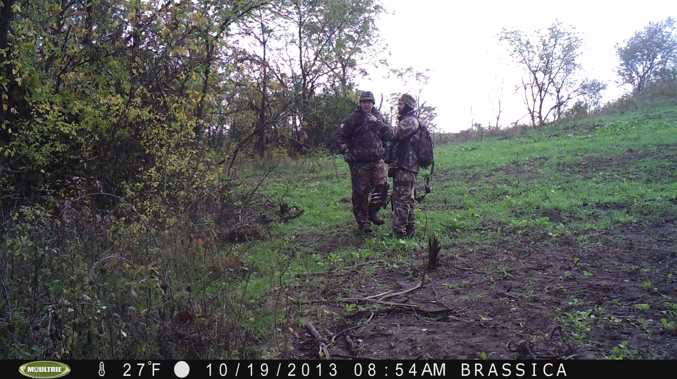 One of my trail cameras caught Ryan and I doing some spot scouting after a morning hunt.