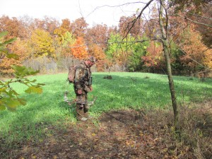 """2013 Archery hunter Ryan Hyer checking out a mock scrape made on the interior plot """"Cage Fight""""."""