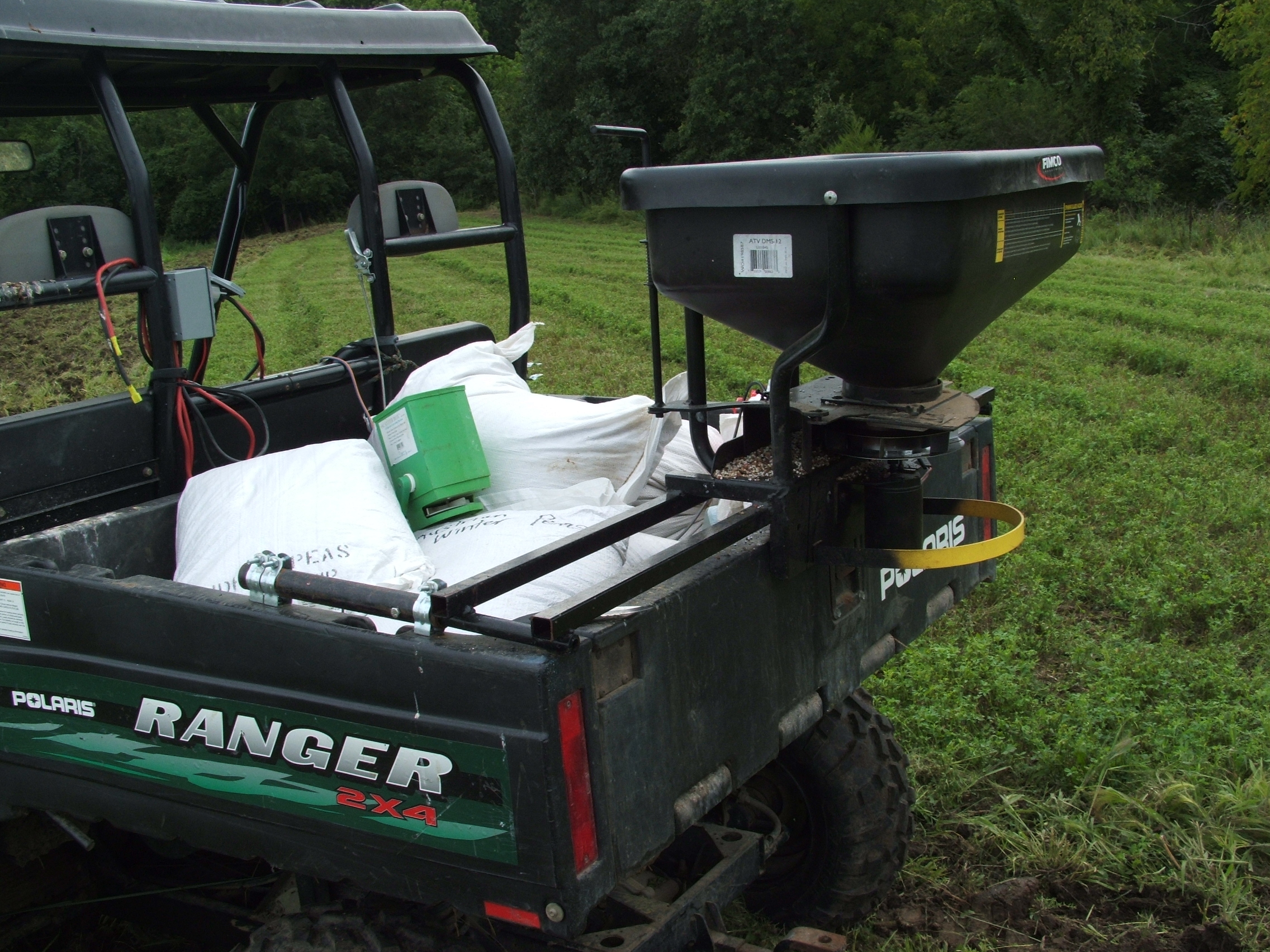 This is my 12volt Fimco seeder.  I altered it so that I can control the seed opening remotely from the front of the Ranger.  The speed is also controlled remotely from a variable speed drive.  This is a very good high end set up.