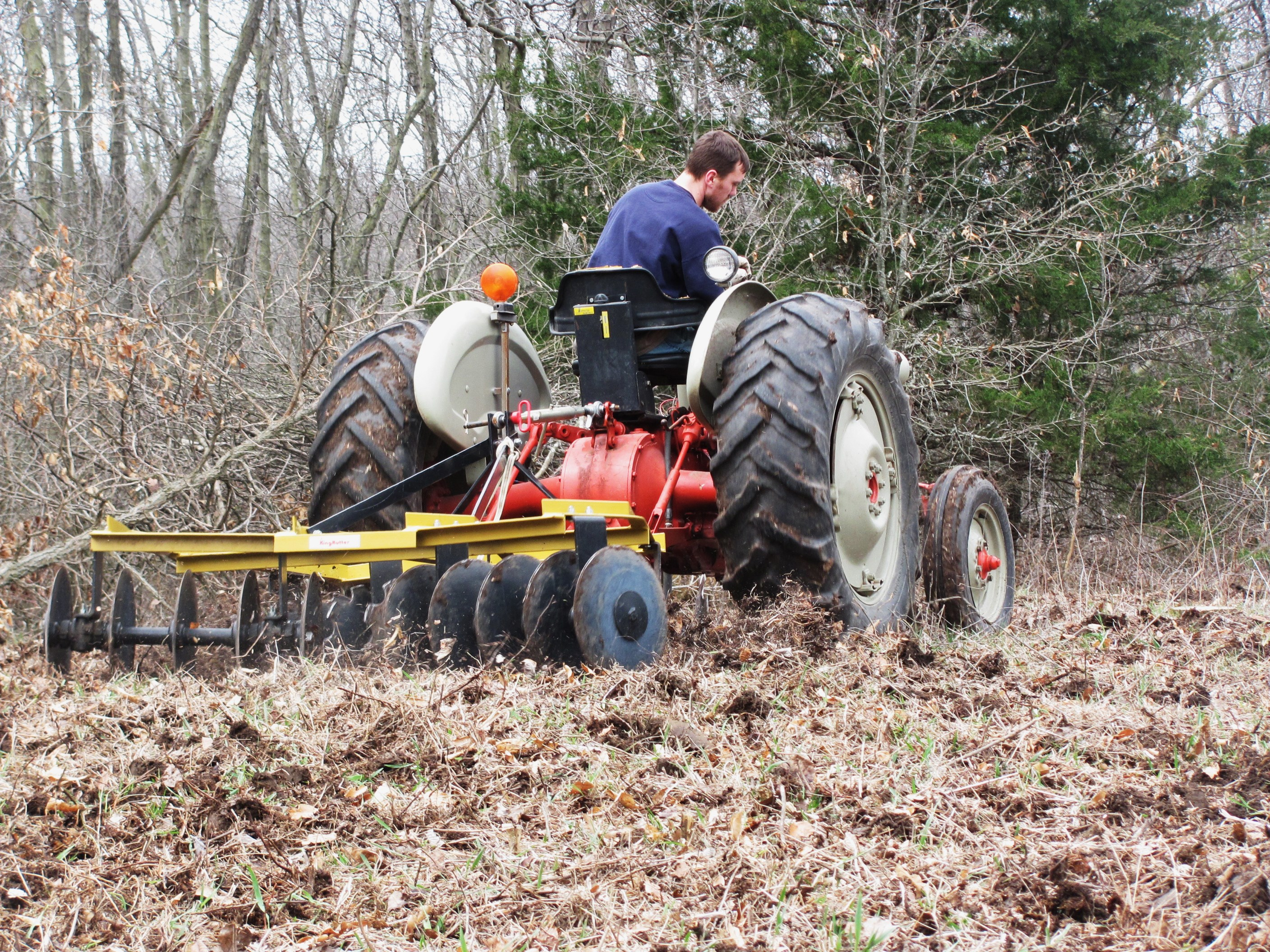 This is my Ford 861 and 6.5 foot King Kutter disc.  A tractor and disc is the best all purpose set up for food plots.  This combo cost me about $4300.