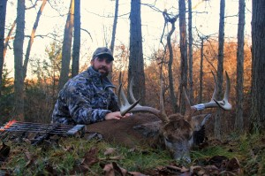 """Marc Alberto with his 10 point Iowa buck taken on the interior plot """"Cage Fight""""."""